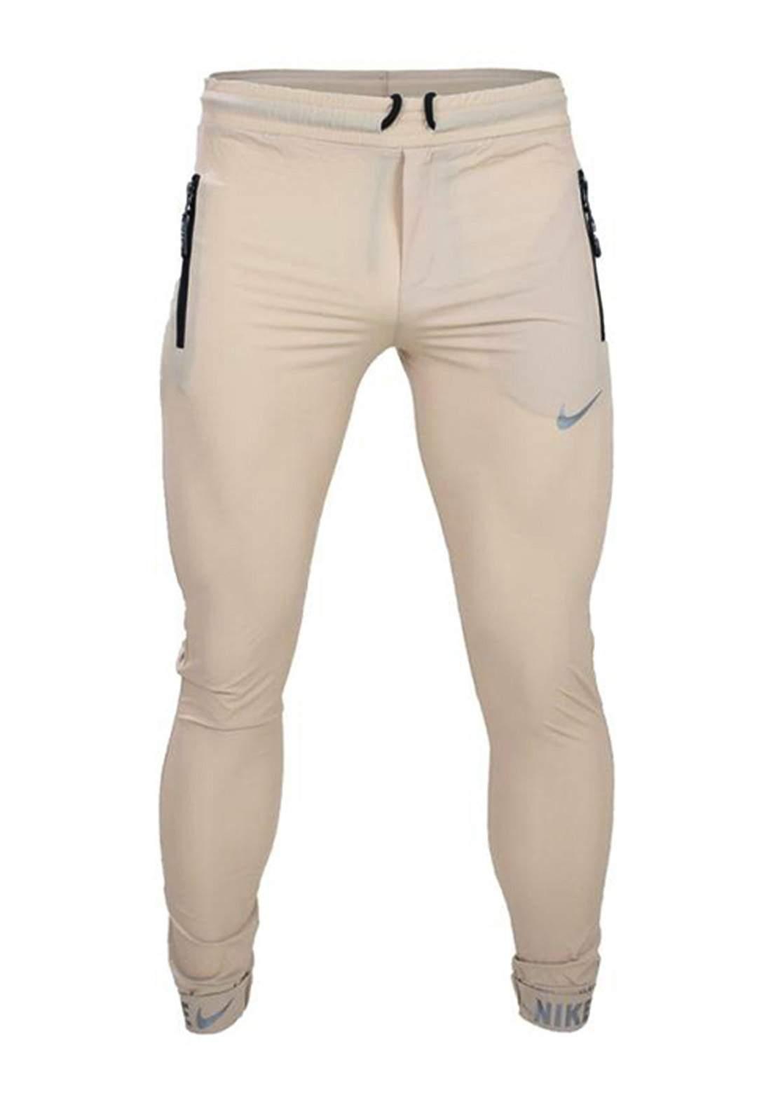 بجامة رياضية بيج أللون من Nike
