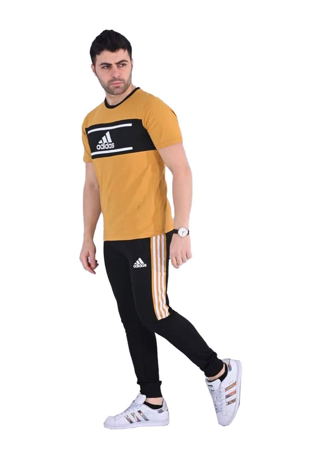adidas Track تراكسوت رجالي اصفر اللون