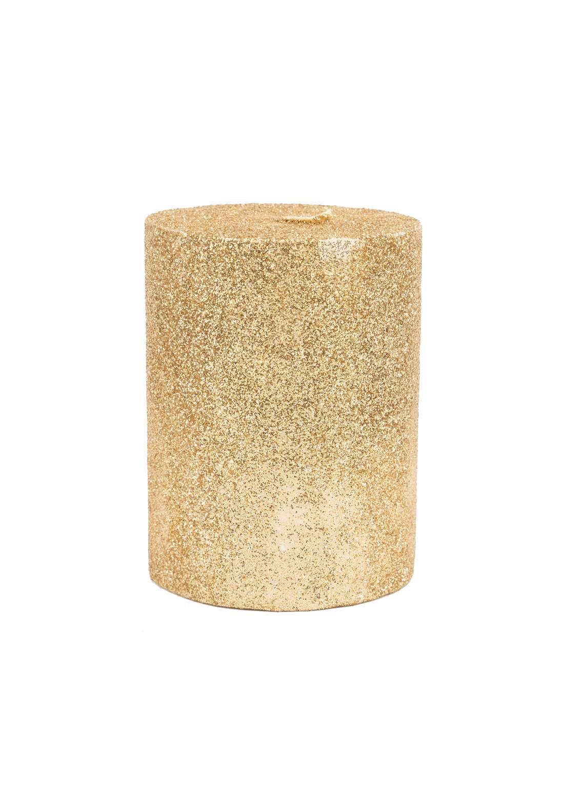 شمعة لامعة ذهبية اللون